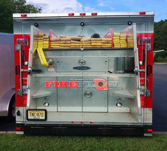 Custom wrap design on enclosed trailer to make the trailer look like an actual firetruck!