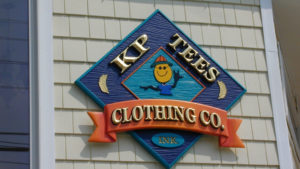 Carved gold leaf sign for ocean county retail store