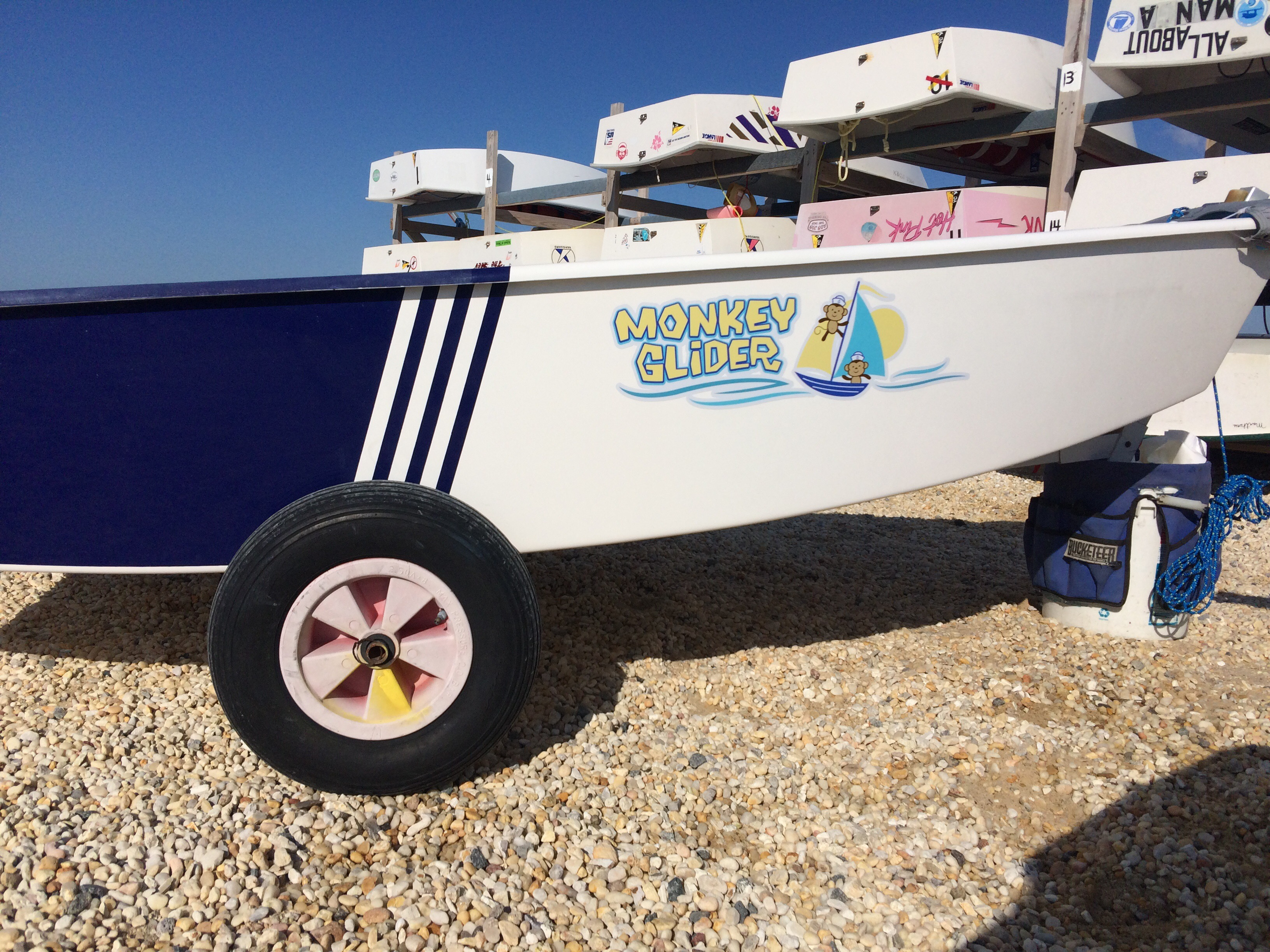 Custom logo and lettering for opti sail boat in Surf City at SCYC.