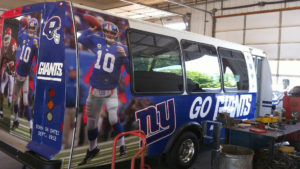 Tailgate van, bus, and RV wraps by Typestries